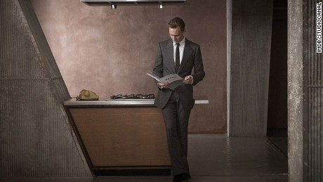 Dr Robert Laing (Tom Hiddleston) inspects his Brutalist apartment.