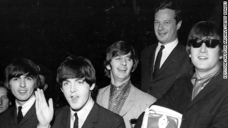 Epstein (second right) with the Fab Four in 1964.