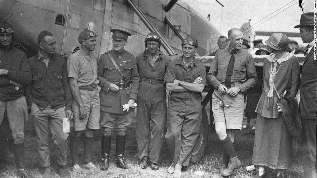 "The earliest flight around the world was by two U.S. Army Douglas DWC seaplanes in 1924. The ""Chicago"" was piloted by Lieutenant Lowell H. Smith (left) and Lieutenant Leslie P. Arnold (second from left), and the ""New Orleans"" by Lieutenant Erik H. Nelson and Lieutenant John Harding. Their flying time for the 42,398-kilometer trip was 371 hours and 11 minutes."