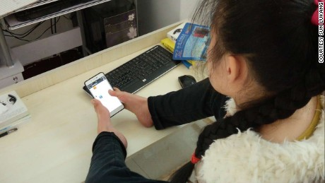 Sun Lukang types on her smart phone with two toes. She has published four books since 2005.