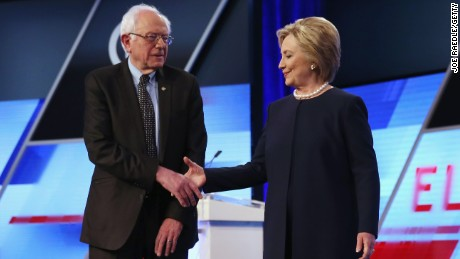 Bernie Sanders and Hillary Clinton shake hands before the Univision News and Washington Post Democratic Presidential Debate on March 9, 2016, in Miami.
