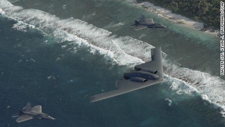 Two F-22 Raptors and a B-2 Spirit bomber deployed to Andersen Air Force Base, Guam, fly in formation over the Pacific Ocean.  The deployment to Andersen marks the first time F-22s and B-2s, the key national strategic stealth assets in the Air Force inventory, deployed together outside the continental United States. (U.S Air Force photo/Master Sgt. Kevin J. Gruenwald)