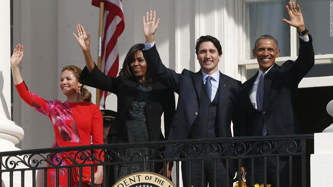 The couples wave from the White House balcony on March 10.