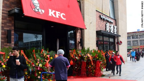 Flower baskets stand outside the storefront of KFC on March 8, 2016.