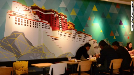 The Potala Palace features as wall art at KFC's first branch in Tibet.