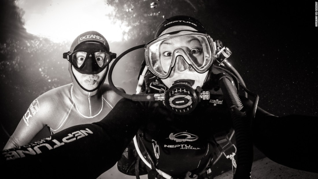 L-R: An underwater selfie with Molchanov and Barrett.<br /><br />