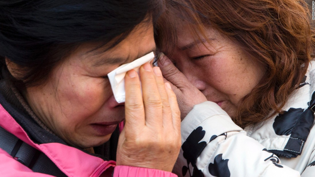 "Relatives of passengers who were on board <a href=""http://www.cnn.com/2014/03/07/asia/gallery/malaysia-airliner/index.html"" target=""_blank"">Malaysia Airlines Flight 370</a> cry outside a court in Beijing after filing a lawsuit against the airline on Monday, March 7. The plane disappeared two years ago with 239 people aboard."
