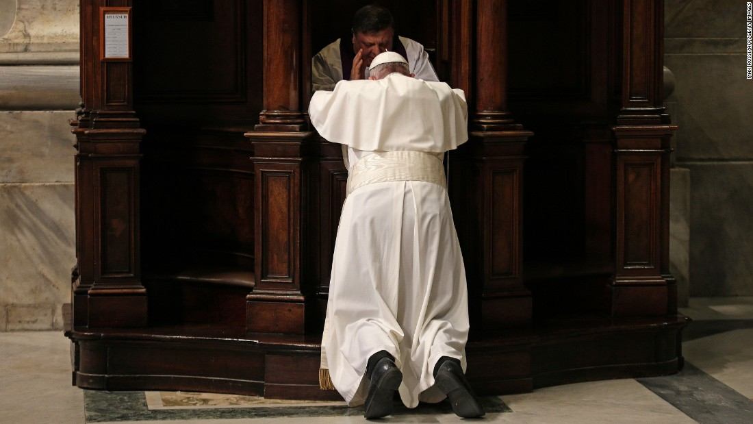 Pope Francis confesses in St. Peter's Basilica during the Vatican's penitential celebration on Friday, March 4.