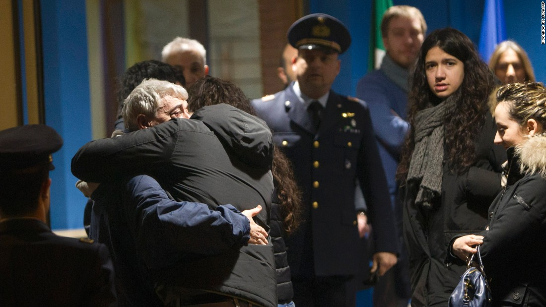 "Gino Pollicardo, left, is hugged by a relative after he arrived at an airport in Rome on Sunday, March 6. Pollicardo is one of four Italian construction workers who were kidnapped in Libya in July. Two of them -- Pollicardo and Filippo Calcagno -- <a href=""http://www.cnn.com/2016/03/09/middleeast/libya-italians-hostages/index.html"" target=""_blank"">were freed this month.</a> The other two, Salvatore Failla and Fausto Piano, were killed during a raid near Sabratha, Libya."