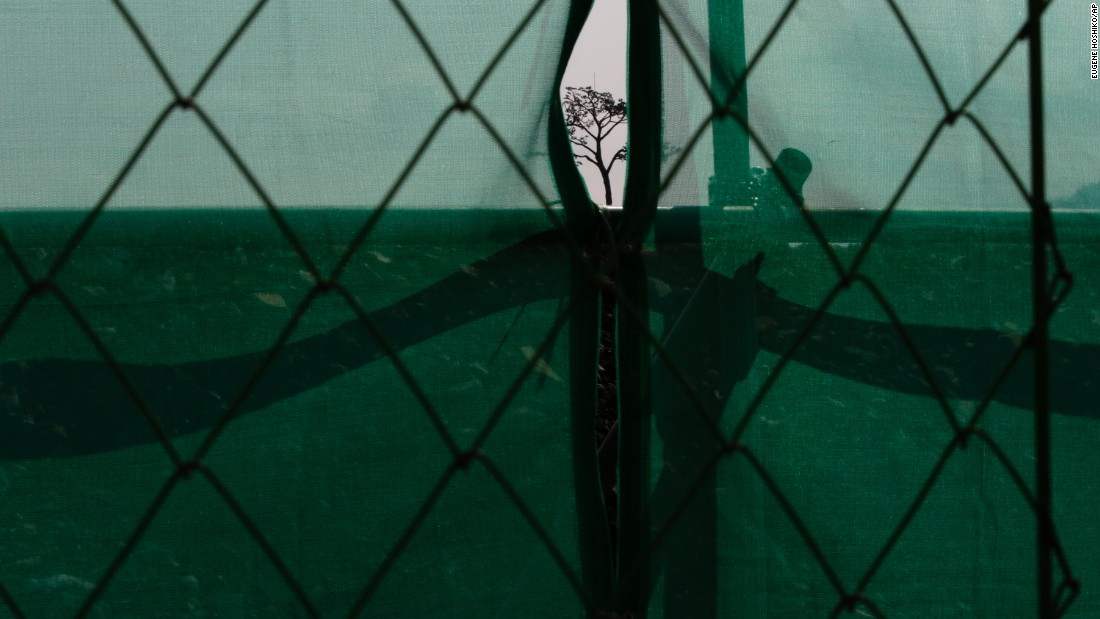 "A lone pine tree is seen through a construction safety net in Rikuzentakata, Japan, on Tuesday, March 8. The tree <a href=""http://globalpublicsquare.blogs.cnn.com/2014/03/20/japans-miracle-pine-reminder/"" target=""_blank"">remained upright</a> after an earthquake and tsunami in 2011. Though it later died, it has been restored with artificial materials and put back where it was found as a symbol of hope and survival."