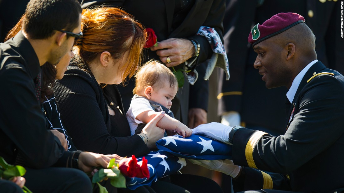 "Alexandra McClintock and her son Declan attend the burial of her husband, Army Sgt. 1st Class Matthew McClintock, in Arlington, Virginia, on Monday, March 7. The 30-year-old soldier was posthumously awarded the Silver Star for his actions in Afghanistan, <a href=""http://www.armytimes.com/story/military/2016/03/07/fallen-green-beret-earns-silver-star-final-act-heroism/81431456/"" target=""_blank"">according to the Army Times.</a>"