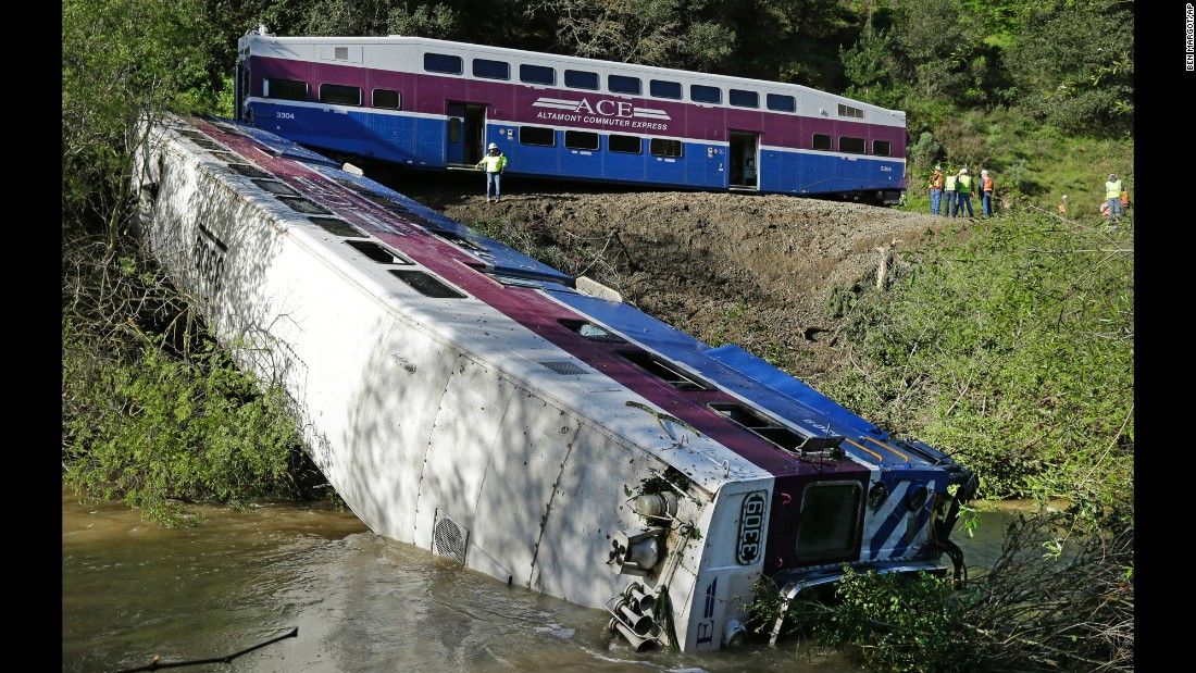 "Workers investigate the scene of a derailed train in Sunol, California, on Tuesday, March 8. Nine people were hurt when the train's lead car <a href=""http://www.cnn.com/2016/03/08/us/california-train-derailment/"" target=""_blank"">went off the rails and ended up in a creek.</a> The derailment was likely caused by a mudslide, with a ""pretty significant big"" tree being a secondary cause, Union Pacific spokesman Francisco Castillo said."