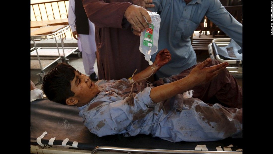 """A boy injured in a suicide attack is transported at a hospital in Peshawar, Pakistan, on Monday, March 7. <a href=""""http://www.cnn.com/2016/03/07/asia/pakistan-suicide-attack/"""" target=""""_blank"""">At least 17 people were killed</a> and at least 31 were injured in the attack, police said. A spokesman for the Pakistani Taliban claimed responsibility."""