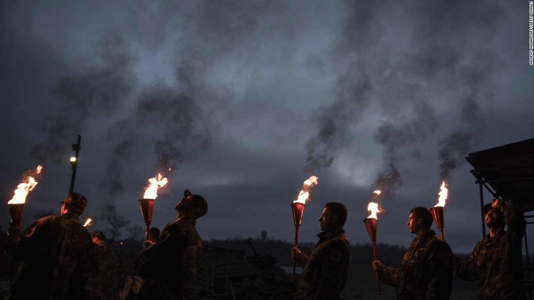 Kosovo Albanians take part in Night of the Fires, an annual bonfire ceremony in the village of Prekaz on Monday, March 7. On March 7, 1998, 46 troops with the Kosovo Liberation Army were killed by Serbian forces during the Kosovo War.