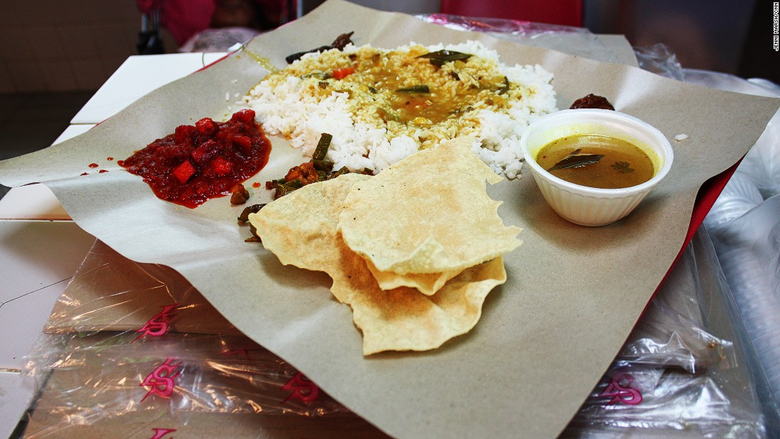 No frills means no frills. Curry, rice and popadoms are served on a piece of baking paper.