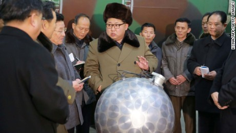 This undated picture released from North Korea's official Korean Central News Agency (KCNA) on March 9, 2016 shows North Korean leader Kim Jong-Un (C) meeting with the scientists and technicians in the field of researches into nuclear weapons and guiding the work for boosting the  nuclear arsenal at an undisclosed location. / AFP / KCNA / KCNAKCNA/AFP/Getty Image