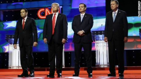 Republican presidential candidates, Sen. Marco Rubio, R-Fla., left, Donald Trump, Sen. Ted Cruz, R-Texas,  and Ohio Gov. John Kasich, right,  stand together before the start of the Republican presidential debate sponsored by CNN, Salem Media Group and the Washington Times at the University of Miami,  Thursday, March 10, 2016, in Coral Gables, Fla. (AP Photo/Alan Diaz)