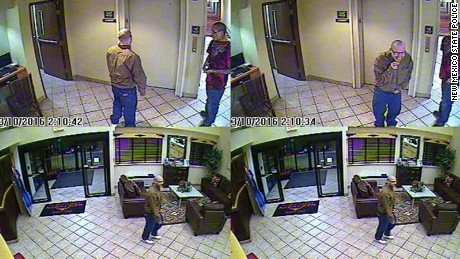 Police say a surveillance image shows Joseph Cruz, in the tan shirt, and Lionel Clah in Albuquerque.