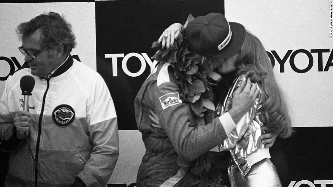 Hunt celebrates his win at 1977 United States Grand Prix with a Penthouse Pet on the podium.