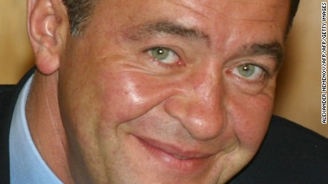 This photo taken on August 23, 2002 shows Russian Minister of Press, Television and Radio Broadcasting, Mikhail Lesin during his trip to Vladivostok with Russian president. Controversial Russian media mogul Mikhail Lesin, who helped found the RT English-language television network, has been found dead at a Washington hotel on November 6, 2015. He was 57. AFP PHOTO / ALEXANDER NEMENOV        (Photo credit should read ALEXANDER NEMENOV/AFP/Getty Images)