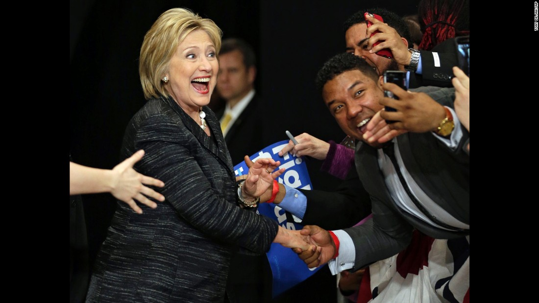 Democratic presidential candidate Hillary Clinton takes selfies with supporters before speaking during a rally at Cuyahoga Community College in Cleveland on Tuesday, March 8.