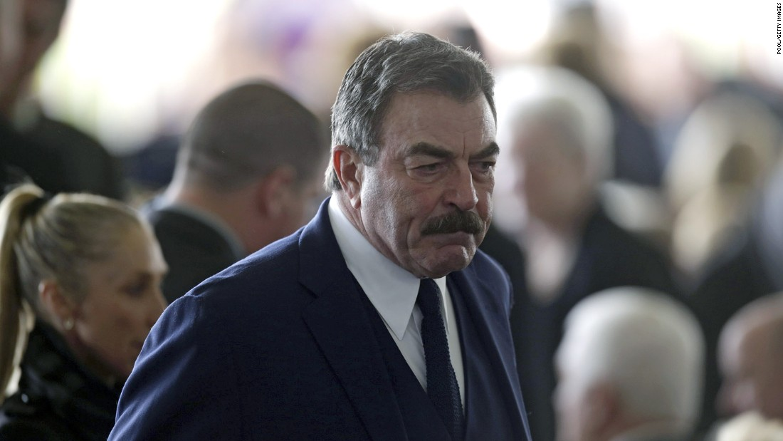 Actor Tom Selleck arrives.