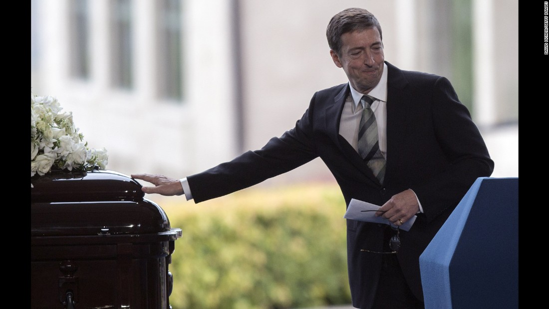 Ron Reagan touches the casket of of his mother during her funeral.