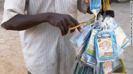 A vendor sells bags of rat poison in northern Nigeria's largest city of Kano. Lassa fever, a virus spread by rats with symptoms similar to Ebola, is endemic to Sierra Leone, Liberia, New Guinea and Nigeria. An American physician assistant suspected of having the virus is being transported from West Africa to Emory University Hospital in Atlanta for treatment.
