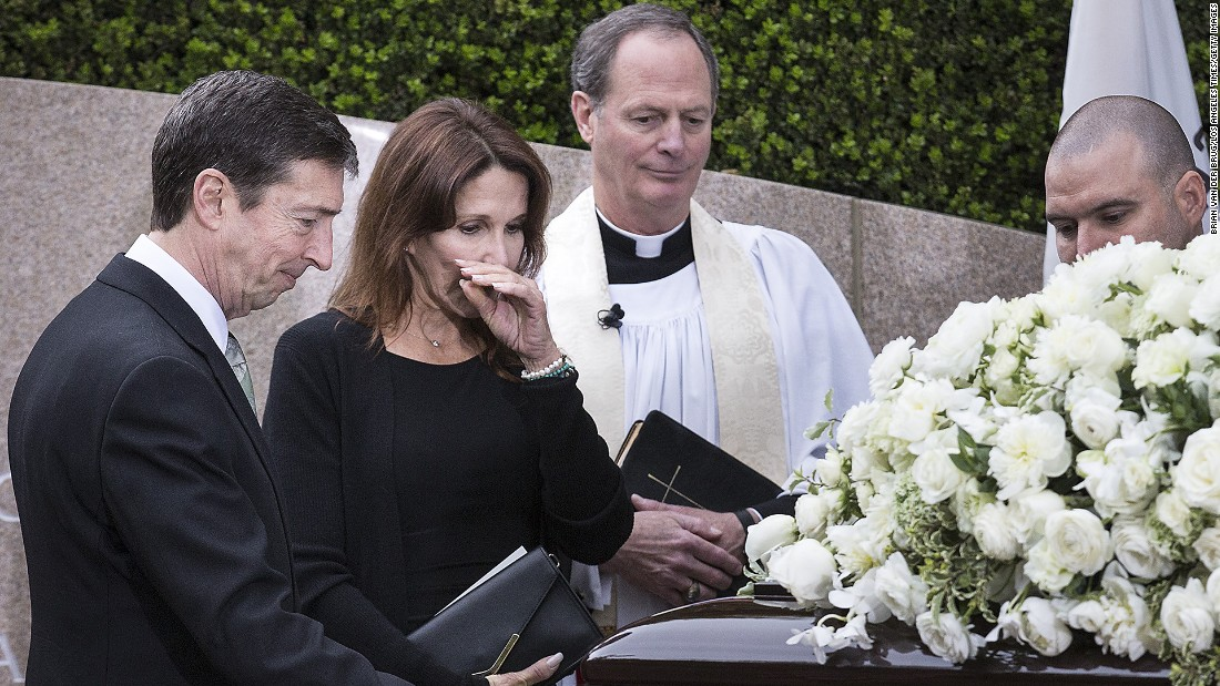 Ron Reagan, left, and sister Patti Davis pause at their mother's casket.