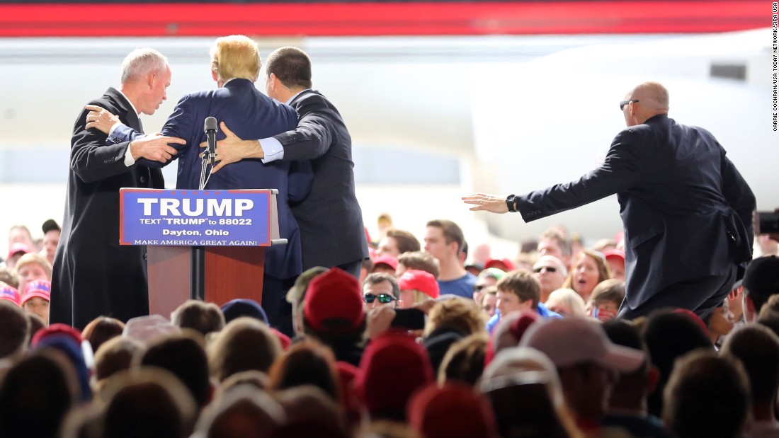 "Republican presidential candidate Donald Trump is escorted off the stage by Secret Service agents after a man<a href=""http://www.cnn.com/2016/03/12/politics/donald-trump-protests/index.html"" target=""_blank""> jumped a barrier and tried to rush the stage</a> during a campaign rally at Dayton International Airport in Ohio on Saturday, March 12."