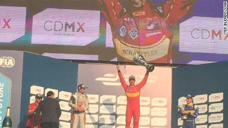 Lucas di Grassi (center) celebrates on the podium following Formula E's first ever race in Mexico.
