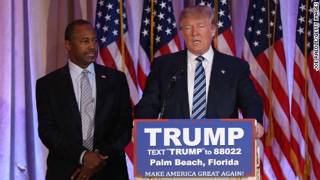 Republican presidential candidate Donald Trump stands with former presidential candidate Ben Carson as he receives his endorsement at the Mar-A-Lago Club on March 11, 2016 in Palm Beach, Florida.