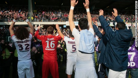 Paris Saint-Germain's team celebrates with its supporters after clinching its fourth straight Ligue 1 title and sixth overall.