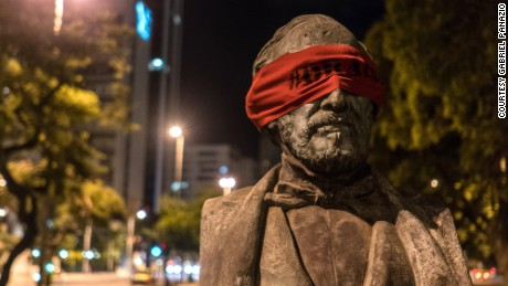 Artist blindfolds statues in Brazil
