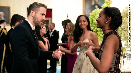 "Malia Obama offered some sisterly support as Sasha Obama talked to ""Dead Pool"" star Ryan Reynolds."