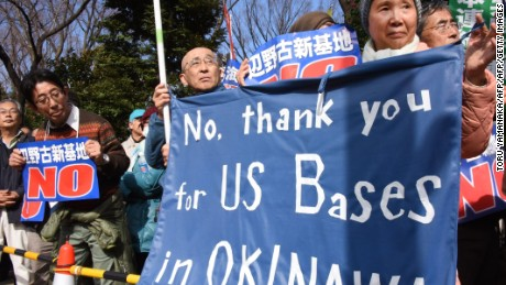 Demonstrators protest the construction of a US Marine air base in the remote Henoko part of Okinawa island, to replace the existing Futenma facility, in front of the National Diet in Tokyo on February 21, 2016.