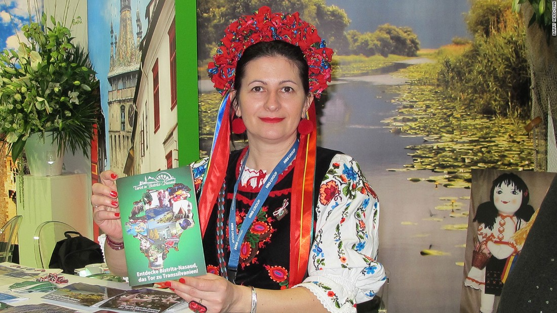 Romania was working overtime at ITB, with roving men in straw hats, musicians, potters, food and this woman in a charming bonnet.