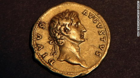 "A picture taken on March 14, 2016 shows a 24 karat gold coin that was minted in Rome in 107 CE and bears the portrait of the emperor ""Augustus Deified"" after it was found by an Israeli hiker the previous week in the eastern Galilee before being handed to the Israeli authorities in Jerusalem."