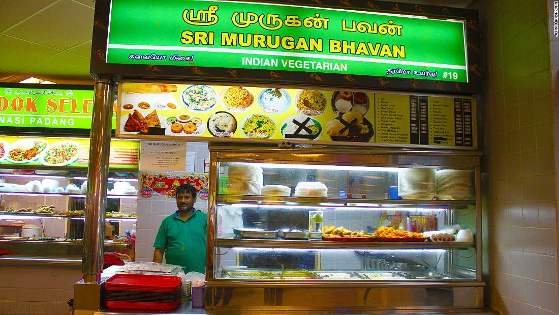 The Sri Murugan Bhavan stall sells vegetarian Indian food on trays covered in baking paper.