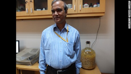 Dr. Rashidul Haque keeps a jar of worms in his office as a reminder of public health progress.