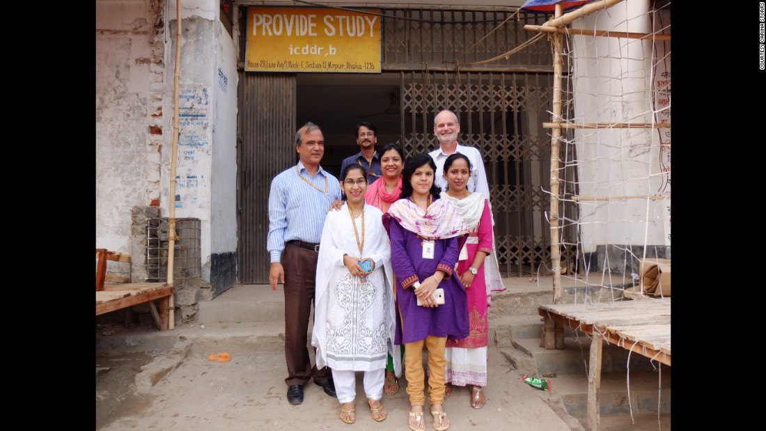 Dr. Rashidul Haque, left, and Dr. William Petri, rear right, and their colleagues stand at the entrance to the clinic where they are investigating why the rotavirus vaccine does not work as well in Bangladesh as it does in high-income countries. They're looking for ways to improve its performance.