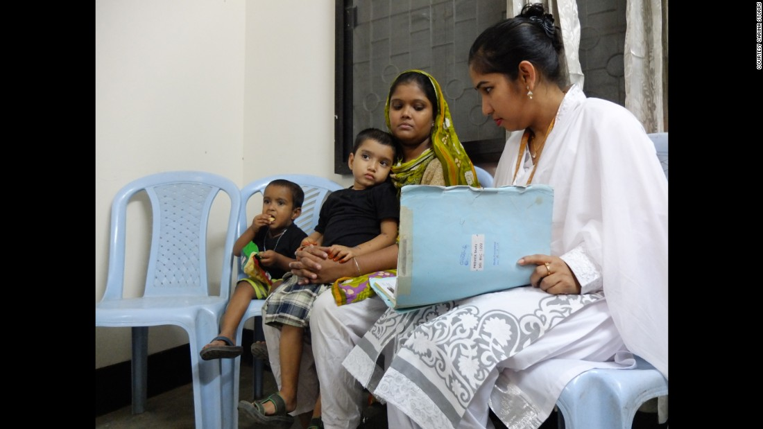 Nasima Begum and her son, Mohommad Mustakim, talk with a researcher while her younger son, Amin, has a snack. The family participated in a clinical study in Dhaka, Bangladesh, that tested the efficacy of the rotavirus vaccine. Rotavirus is a major cause of severe diarrhea worldwide, but the vaccine doesn't work well in Bangladesh and other low-income countries, and researchers are trying to find out why.