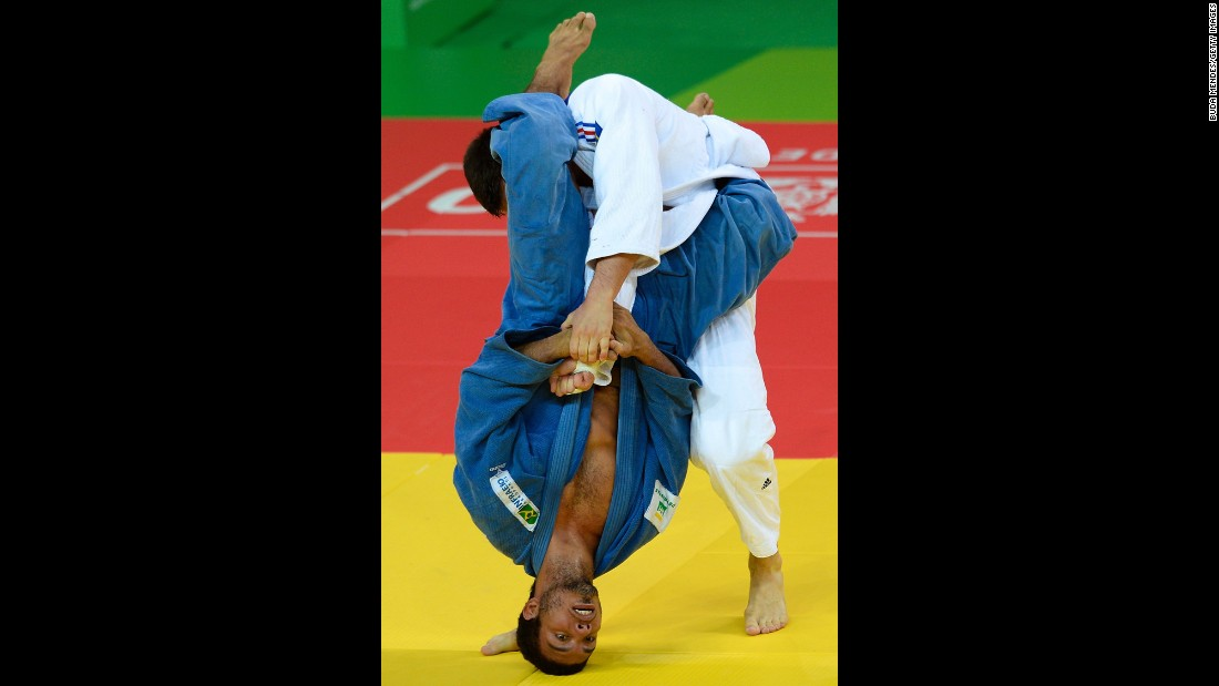 Nicolas Chilard, on top, of France fights with Igor Pereira of Brazil during the International Judo Tournament at the Olympic Park on Wednesday, March 9, in Rio de Janeiro.