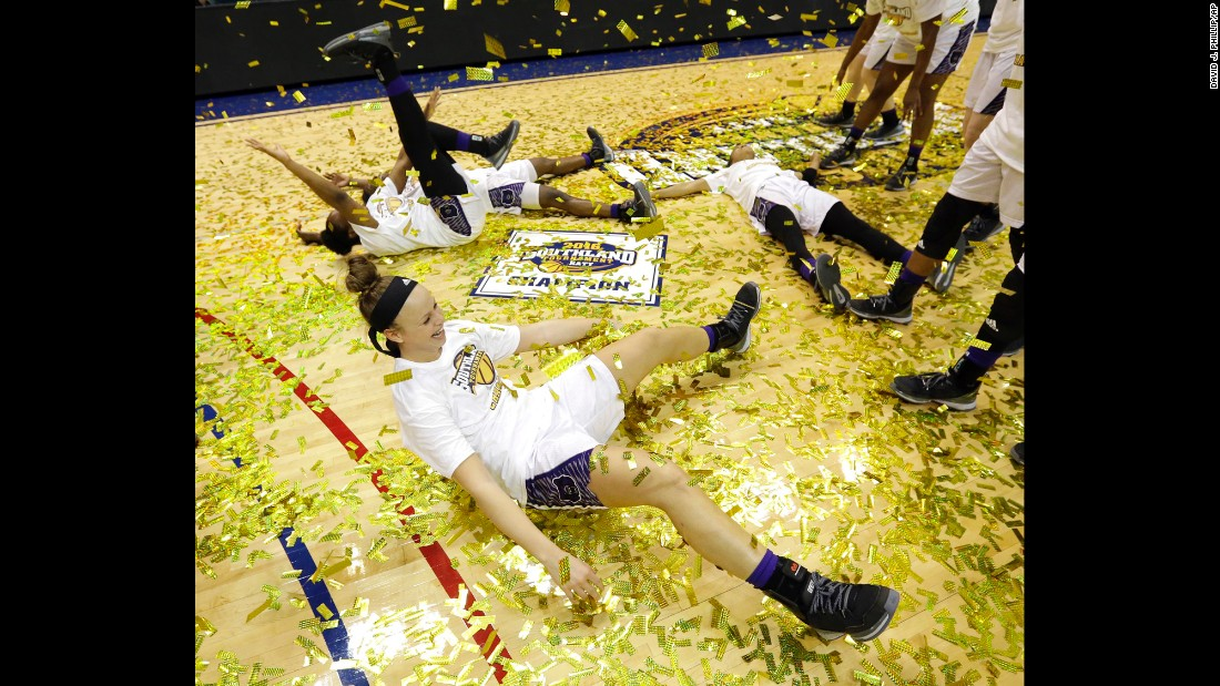 Central Arkansas' Maggie Proffitt plays in confetti on the floor with teammates while celebrating a win over Sam Houston State in an NCAA college basketball game in the championship of the Southland Conference Tournament, on Sunday, March 13, in Katy, Texas.