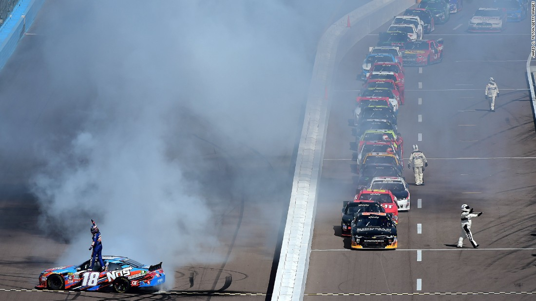 Kyle Busch, driver of No. 18, celebrates with a burnout after winning the NASCAR Xfinity Series at Phoenix International Raceway on Saturday, March 12, in Avondale, Arizona.