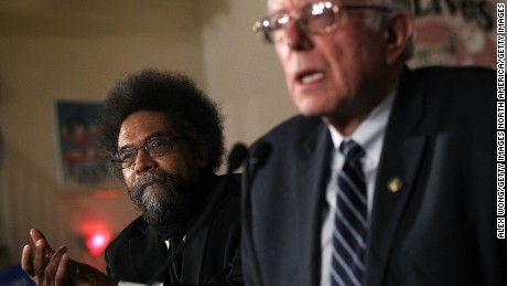 DAVENPORT, IA - JANUARY 29:  Democratic presidential candidate Sen. Bernie Sanders (I-VT) (R) speaks to voters as philosopher and social activist Cornel West (L) listens during a campaign rally at Danceland Ballroom January 29, 2016 in Davenport, Iowa. Sanders continued to seek support for the Democratic nomination prior to the Iowa caucus on February 1.  (Photo by Alex Wong/Getty Images)