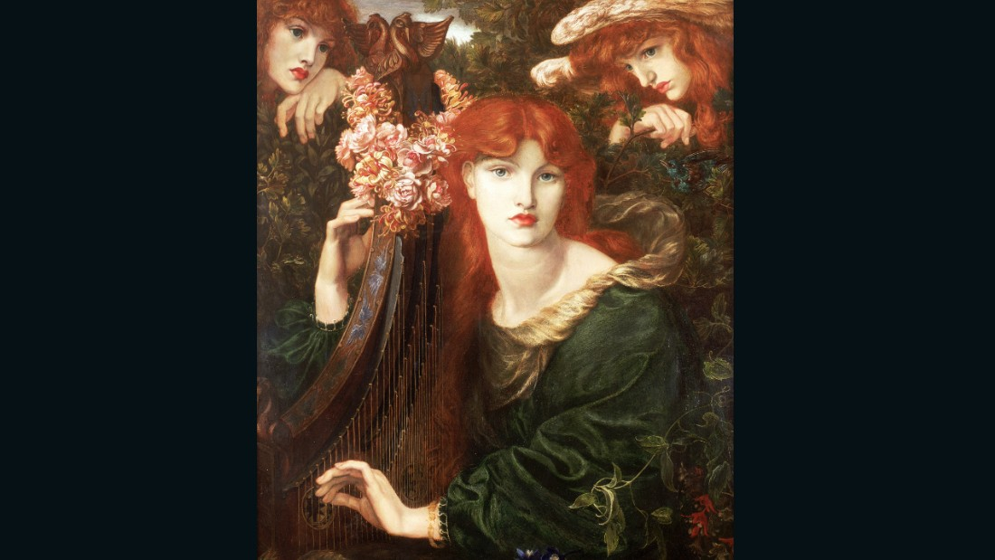 "Once described by Rossetti is ""the greenest picture in the world,"" La Ghirlandata is one of several three-quarter-length paintings by the artist of women making music. Painted at Kelmscott Manor, some believe Morris' eleven-year-old daughter May posed for the angels pictured in the top corners, a similar trope to that seen in Botticelli's workshop tondo Virgin and Child."
