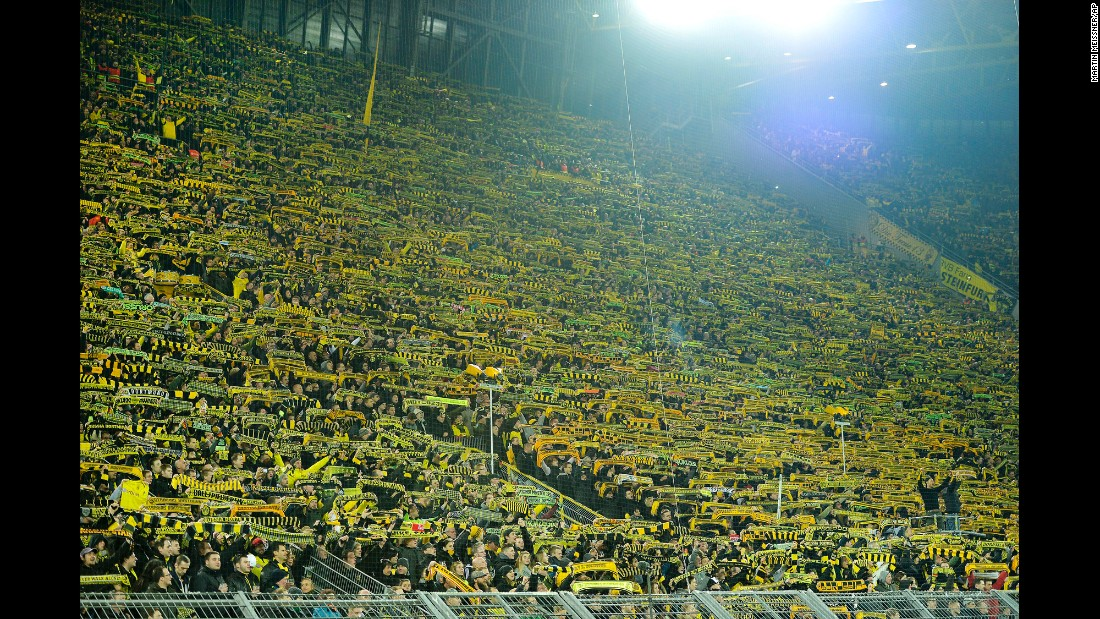 "The Borussia fans on the southern tribune sing ""you will never walk alone"" after a supporter died of a heart attack during the German Bundesliga soccer match between Borussia Dortmund and FSV Mainz 05 in Dortmund, Germany, on Sunday, March 13."