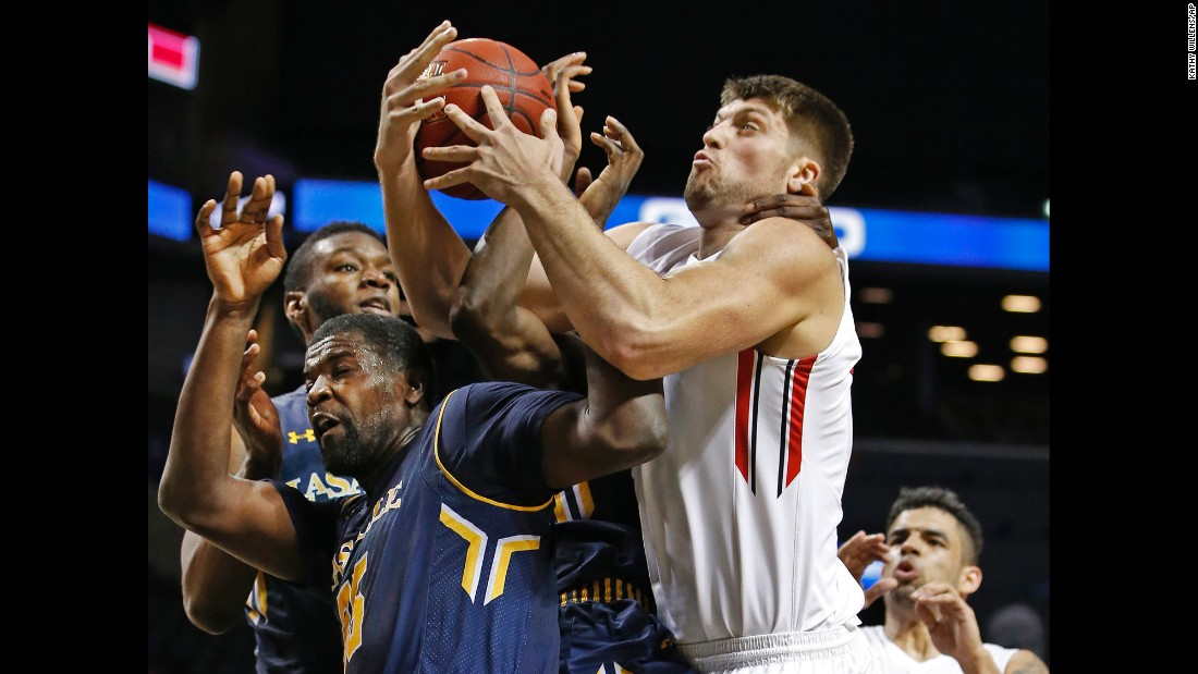 La Salle guard Rohan Brown, left, and other La Salle players get tangled up with Davidson forward Andrew McAuliffe, right, who gets choked after stripping the ball from Brown during the second half of an NCAA college basketball game on Thursday, March 10, in New York.