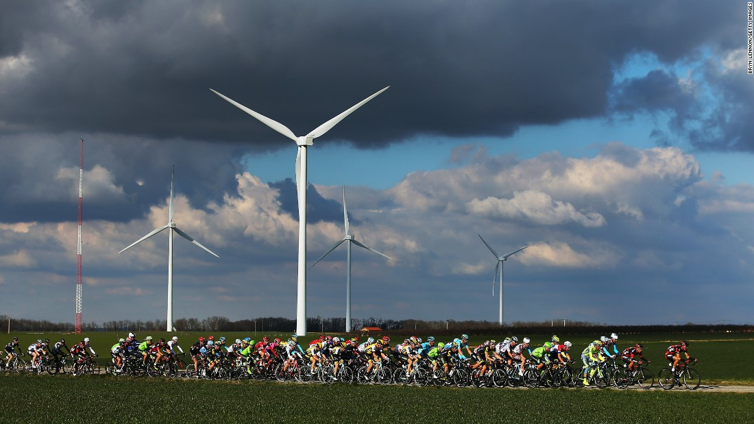 The peloton passes a wind farm on stage four of the 2016 Paris-Nice on Thursday, March 10, in Romans-sur-Isere, France.